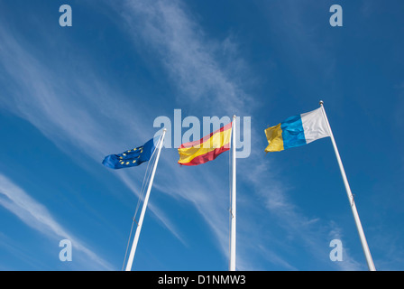 The Flags of the European Union,Spain and the Canary Islands under a blue sky - Stock Photo