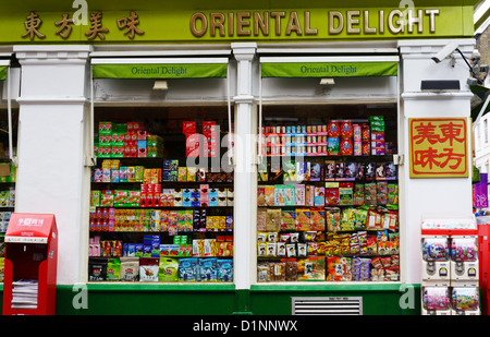 Window display of Oriental Delight Chinese food shop in Soho's Chinatown, London. - Stock Photo