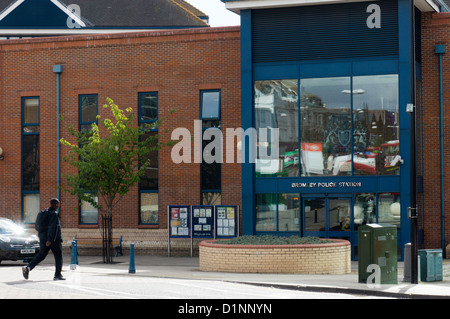 A man walking towards the entrance to Bromley Police Station in South London. - Stock Photo