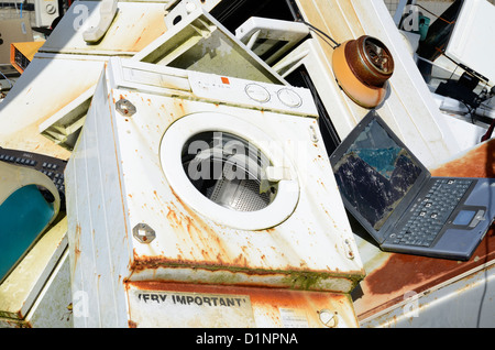 Old household electrical appliances at a recycling center - Stock Photo