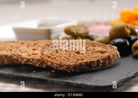 assorted fresh cold cut platter Italian appetizer - Stock Photo