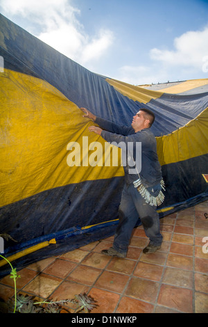 ... Hispanic workmen in Laguna Niguel CA cover a home with a gasproof tent prior & Tent fumigation of home Stock Photo Royalty Free Image: 140924245 ...