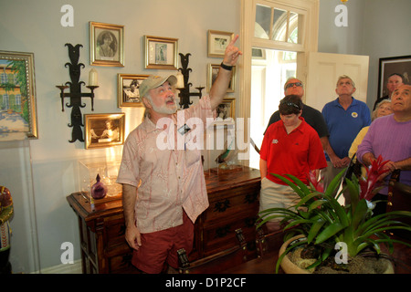 Florida Key West Florida Keys Whitehead Street The Ernest Hemingway Home & and Museum house interior guide pointing - Stock Photo