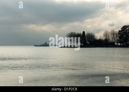 A passenger ferry on Lac Leman, near Geneva, Switzerland, on a cold, dull, winter's day - Stock Photo