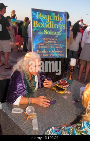 Florida Key West Florida Keys Gulf of Mexico water Mallory Square Sunset Celebration psychic palm reader woman fortune - Stock Photo