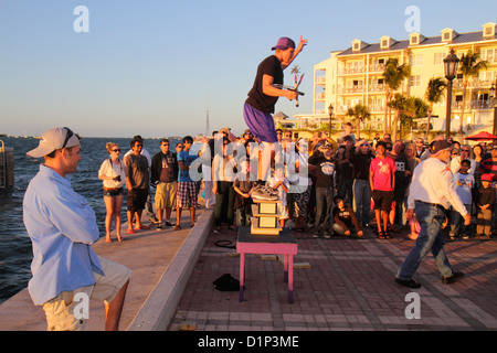 Florida Key West Florida Keys Gulf of Mexico water Mallory Square Sunset Celebration juggler performer Gulf of Mexico - Stock Photo