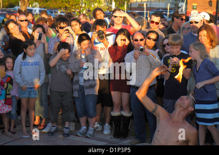 Florida Key West Florida Keys Gulf of Mexico water Mallory Square Sunset Celebration performer man audience watching - Stock Photo