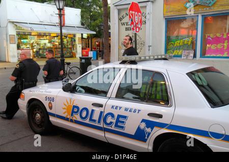 Florida Key West Florida Keys Duval Street police car policemen - Stock Photo