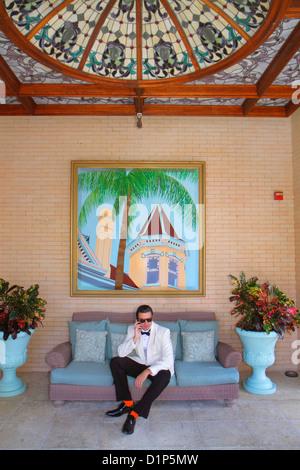 Florida Key West Florida Keys Duval Street Southernmost House Key West Historic Inn entrance man white suit tuxedo - Stock Photo