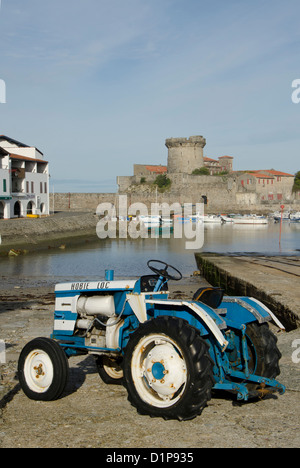 Tractor in front of Fort Socoa on the french basque coast - Stock Photo