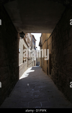 steep Narrow Spanish back street with blue sky - Stock Photo