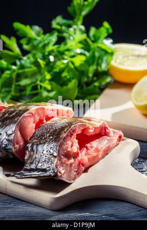 Fresh fish with lemon and salt - Stock Photo