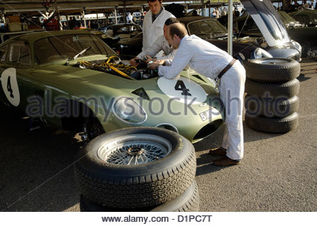 mechanics working on the engine of the 1963 Aston Martin Project 214 race car prototype - Stock Photo