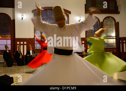 Whirling Dervish Sema Ceremony with musicians and women dancers Istanbul Turkey - Stock Photo