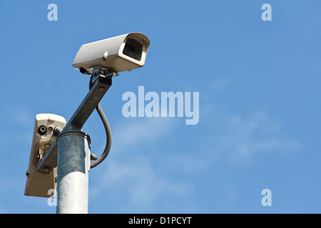 Closed curcuit television cameras or CCTV is modern security equipment for collecting evidence of a crime - Stock Photo