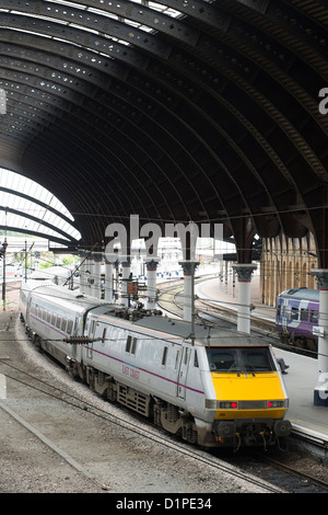 High speed passenger train in East Coast Trains livery waiting at a platform at York Railway Station, England. - Stock Photo