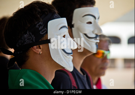 March against corruption - activists wearing Guy Fawkes masks in street protest against corruption in the Brazilian - Stock Photo