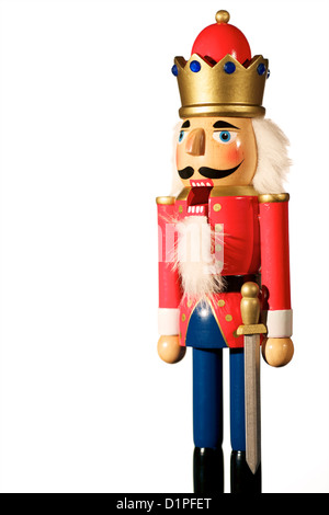 Wooden Nutcracker soldier Christmas decoration with mouth open. - Stock Photo
