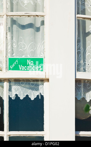 Bed and breakfast sorry no vacancies sign in a window UK GB EU Europe - Stock Photo