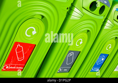 Bright green recycling bins in a row in a town centre England UK GB EU Europe - Stock Photo