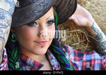 young tattooed stylish woman - Stock Photo