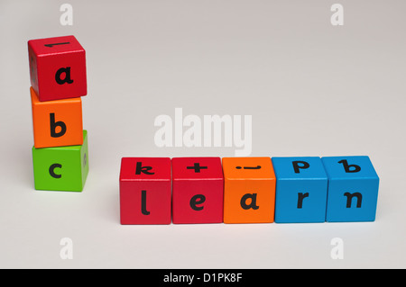 alphabet spelling blocks used to spell the word learn and abc in a childrens play scene. - Stock Photo