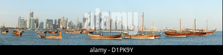 Panoramic view of traditional dhows on display in Doha Bay ahead of Qatar's national day in December 2012 - Stock Photo