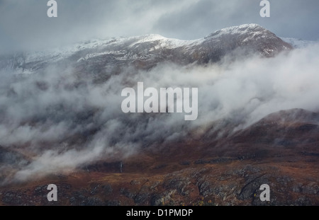 Low cloud around the summits of Sgurr Dubh, Sgurr an Tuill Bhain and the water fall at its base near Loch Maree. - Stock Photo