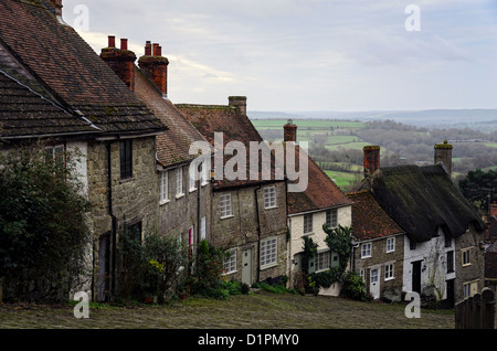 A row of cottages on a steep cobbled street at Gold Hill in Shafetsbury, Dorset - Stock Photo