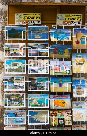 Postcards for sale on a stand outside a tourist shop in St Ives, Cornwall. - Stock Photo