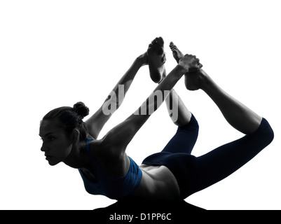 one  woman exercising yoga bow pose in silhouette studio isolated on white background - Stock Photo