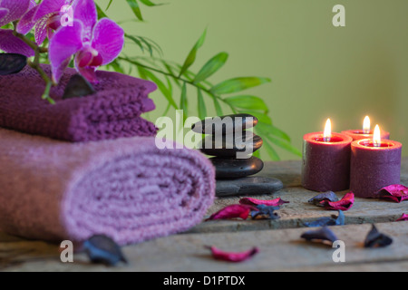 Spa still life with zen stones aromatic candles and orchid - Stock Photo