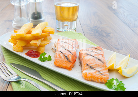 Grilled salmon fillets with chips - Stock Photo