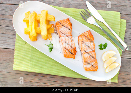 Grilled salmon with chips - Stock Photo