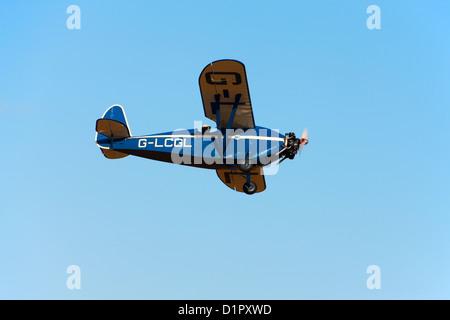 Comper CLA7 Swift Replica G-LCGL in flight - Stock Photo