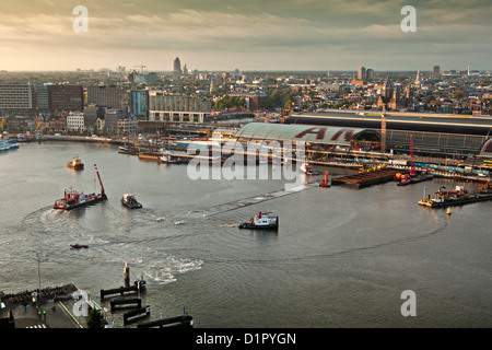 The Netherlands, Amsterdam, Aerial view on transport and placement of part of tunnel for metro or tube. - Stock Photo