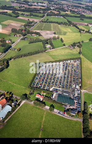 The Netherlands, near Almelo, Car scrap yard, surrounded by farms and farmland. Aerial. - Stock Photo