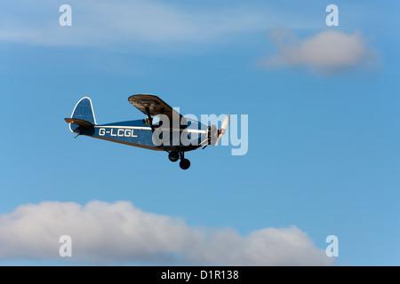 Comper CLA7 Swift Replica G-LCGL in flight over Breighton Airfield - Stock Photo