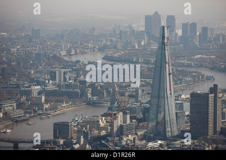 Aerial photograph showing the London skyline with the Shard and Canary Wharf  in the background - Stock Photo