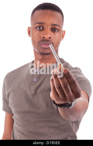 Young african american man offering a cigarette, isolated on white background - Stock Photo