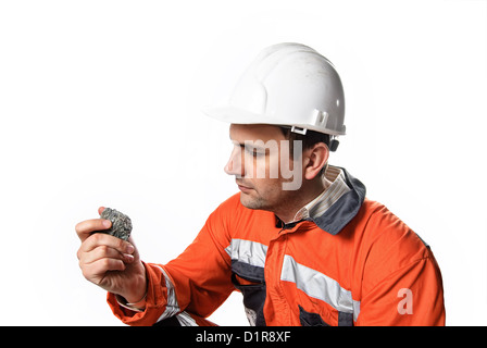 Mine engineer checking mineral isolated on white stock photo - Stock Photo