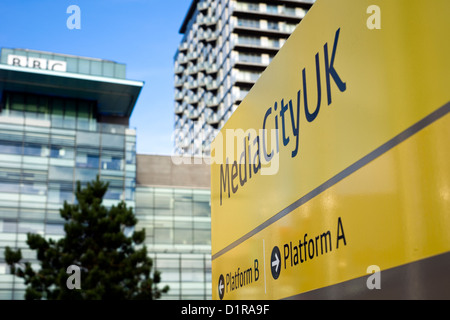 Metro sign outside the BBC's Media City UK television studios at Salford Quays in Manchester, England - Stock Photo