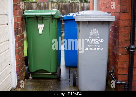 Wheelie bins in a garden in Manchester, England, UK - Stock Photo