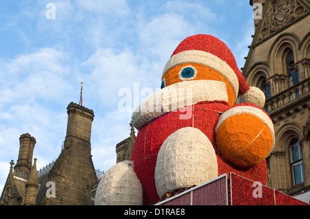 Giant Santa figure outside Manchester town hall in Albert Square, England, UK - Stock Photo