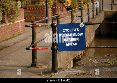 Cyclists please slow down barrier ahead, Bristol quayside February 2008 - Stock Photo
