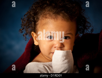 Studio portrait of a cute baby girl, 18 months, mixed race