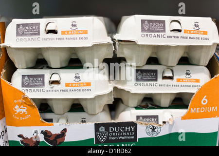 Boxes of free range organic eggs at Waitrose food store - Stock Photo