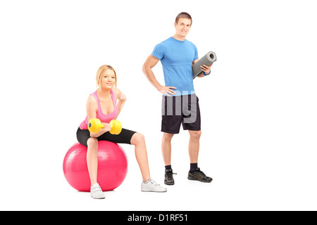 A male and female athletes with equipment posing isolated on white background - Stock Photo