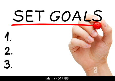 Hand underlining Set Goals with red marker isolated on white. - Stock Photo