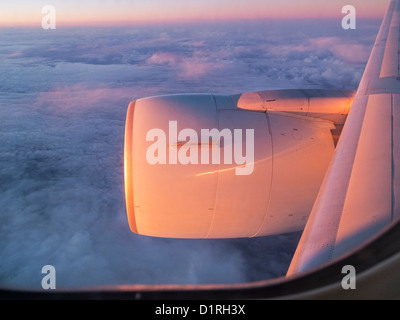 The view from a window seat on an Air Canada Boeing 767 jetliner, somewhere over the Pacific Ocean at sunset - Stock Photo